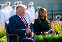 United States President Donald J. Trump gives a thumbs-up as he attends  a ceremony at the Pentagon during the 18th anniversary commemoration of the September 11 terrorist attacks, in Arlington, Virginia on Wednesday, September 11, 2019. at right is First lady Melania Trump.<br /> Credit: Kevin Dietsch / Pool via CNP /MediaPunch