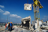 Demolition of Hermes Point, one of two asbestos-ridden towers on Elgin Estate, North Paddington.  The estate was taken over from Westminster City Council by Walterton and Elgin Community Homes (WECH), a resident-controlled housing association.