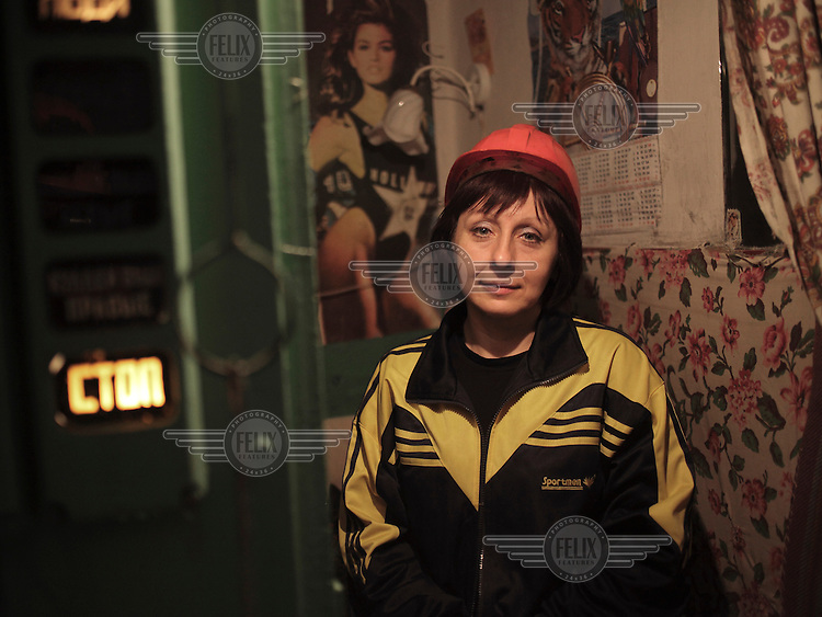 A female miner in the Navagrodovskaya coal mine, West Donetsk.