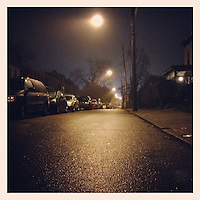 A street light shines on Duval Street in Germantown on a misty and rainy evening December 17, 2012.