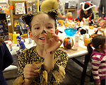 Magdalena Osborn, 7, finds a candy coin at the Carson City Library Monday, Oct. 27, 2014. As part of the library's Halloween festivities, dozens of children decorated pumpkins or gourds and took part in a costume contest.