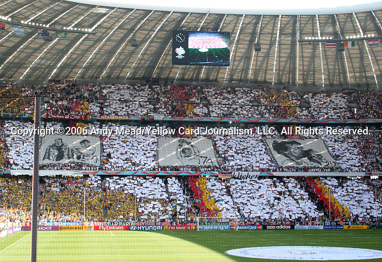 24 June 2006: A wide shot of German fans unfurling three large banners commemorating Germany's three World Championships (1954, 1974, 1990) before the game. Germany (1st place in Group A) played Sweden (2nd place in Group B) at the Allianz Arena in Munich, Germany in match 49, a Round of 16 game, in the 2006 FIFA World Cup.