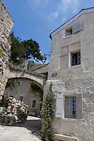 The village facade of the house opens onto a narrow winding street