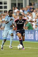 Darrius Barnes (25) defender  New England Revolution gets past Kei Kamara..Sporting Kansas City and New England Revolution played to a 0-0 tie at LIVESTRONG Sporting Park, Kansas City, KS.