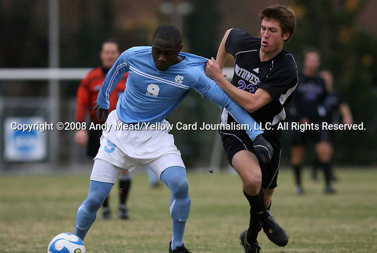 06 December 2008: Northwestern's Matt Eliason (23) pulls on the jersey of North Carolina's Eddie Ababio (9). The University of North Carolina Tar Heels defeated the Northwestern University Wildcats 1-0 at Fetzer Field in Chapel Hill, North Carolina in a NCAA Division I Men's Soccer tournament quarterfinal game.