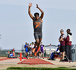 Easst St. Louis triple jumper Raymond Mix at the Norm Armstrong Boys Track and Field Invitational on Wednesday April 11, 2018. He won the event. Photo by Tim Vizer