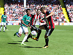 Billy Sharp of Sheffield Utd idk action with Rico Henry of Brentford uring the English championship league match at Bramall Lane Stadium, Sheffield. Picture date 5th August 2017. Picture credit should read: Jamie Tyerman/Sportimage