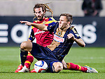 Philadelphia Union forward Andrew Wenger (11) and Real Salt Lake midfielder Kyle Beckerman (5) vie for the ball in the second half Saturday, March 14, 2015, during the Major League Soccer game at Rio Tiinto Stadium in Sandy, Utah. (© 2015 Douglas C. Pizac)