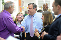 BURLINGTON CITY, NJ -  NOVEMBER 4: New Jersey Governor Chris Christie speaks with supporters while campaigning at Old City Quilts November 4, 2013 in Burlington City, New Jersey. Republican Governor Chris Christie faces Democratic state senator Barbara Buono in the November 5th general election. (Photo by William Thomas Cain/Cain Images)