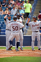 Detroit Tigers Bryan Holaday (50) high fives Casey McGehee (31), Cameron Maybin (4), and Mike Aviles (14) after hitting a home run during a Spring Training game against the New York Yankees on March 2, 2016 at George M. Steinbrenner Field in Tampa, Florida.  New York defeated Detroit 10-9.  (Mike Janes/Four Seam Images)