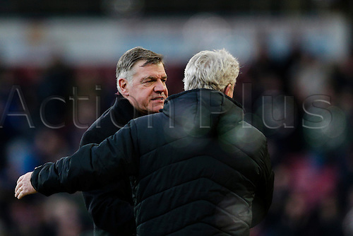 18.01.2015.  London, England. Barclays Premier League. West Ham versus Hull City.  West Ham United manager Sam Allardyce commiserates with Hull City manager Steve Bruce at the end after the home team won 3-0