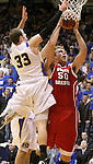 BROOKINGS, SD - JANUARY 12: Trevor Gruis #50 from the University of South Dakota slams has his shot blocked by Griffan Callahan #33 from South Dakota State in the first half Thursday night at Frost Arena in Brookings. (Photo by Dave Eggen/Inertia)