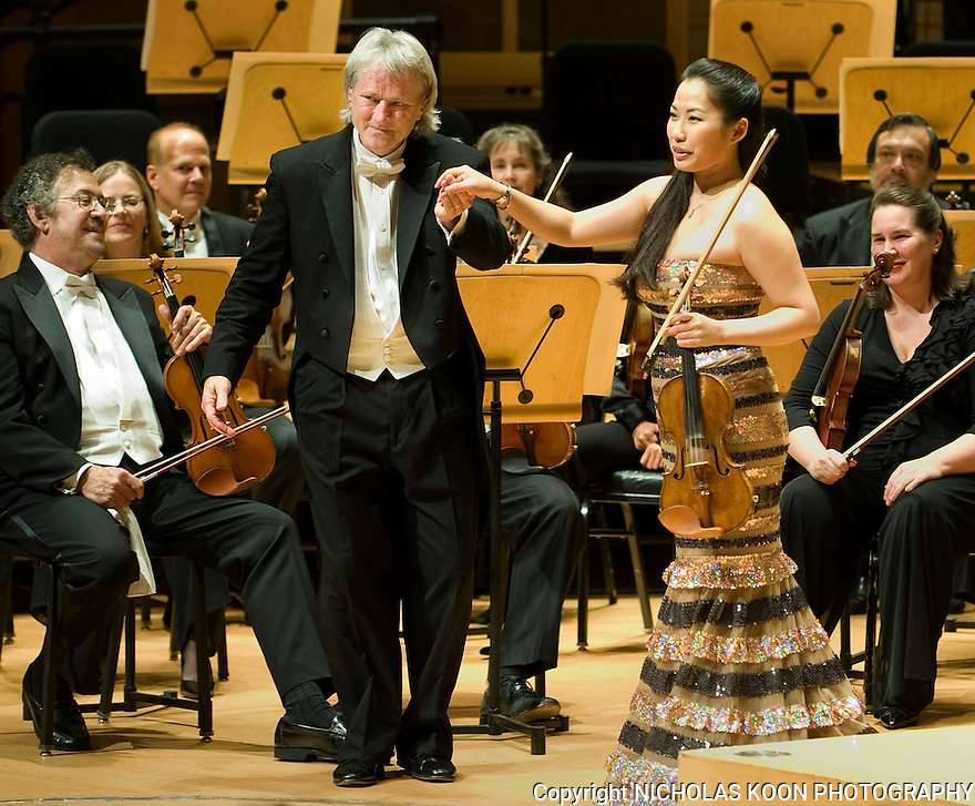 Violinist Sarah Chang and Pacific Symphony conductor Carl St. Clair take a bow after receiving a standing ovation for their performance of Felix Mendelssohn's Concerto in E Minor for Violin and Orchestra (Op. 64) on Thursday evening at the Rene and Henry Segterstrom Concert Hall.  This concert was the season opener for the Pacific Symphony.
