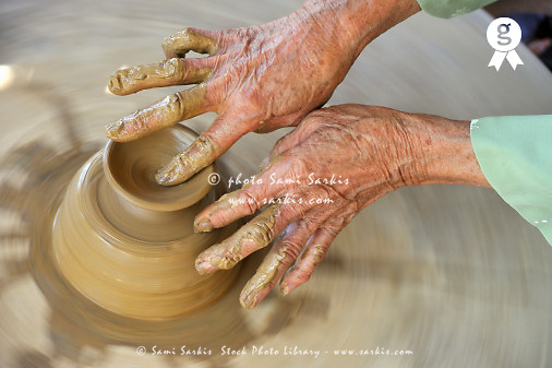 Senior woman hands making pottery (Licence this image exclusively with Getty: http://www.gettyimages.com/detail/83154217 )