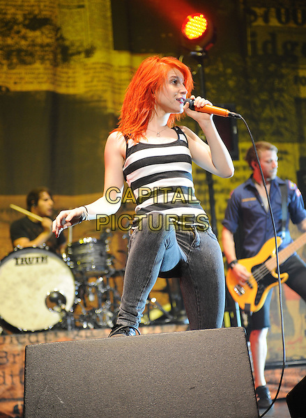 HAYLEY WILLIAMS of Paramore.Performs live during their 2009 summer tour at The Universal Ampitheatre in Universal City, California, USA. .July 22nd, 2009.stage concert live gig performance music grey gray skinny jeans denim white black striped stripes top singing full half 3/4.CAP/DVS.©Debbie VanStory/Capital Pictures.