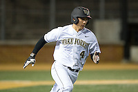 Stuart Fairchild (4) of the Wake Forest Demon Deacons hustles down the first base line against the Georgetown Hoyas at David F. Couch Ballpark on February 19, 2016 in Winston-Salem, North Carolina.  The Demon Deacons defeated the Hoyas 3-1.  (Brian Westerholt/Four Seam Images)