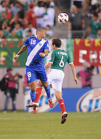 Guatemala Oscar Isaula (18) heads the ball against Guatemala Gerardo Torrado (6)    Mexico defeated Guatemala 2-1 in the quaterfinals for the 2011 CONCACAF Gold Cup , at the New Meadowlands Stadium, Saturday June 18, 2011.