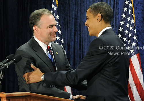 Washington, DC - January 8, 2009 --  Virginia Governor Tim Kaine (L) shakes hands with United States President-elect Barack Obama after Kaine was introduced as the new Chairman of the Democratic National Committee in Washington on Thursday, January 8, 2009. .Credit: Kevin Dietsch - Pool via CNP