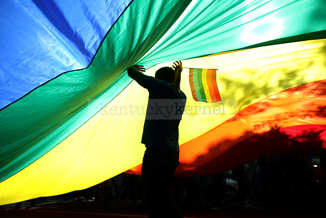 Andrew Hannigan walks under a large rainbow flag during the National Equality March. The march was to fight for equal rights for the LGBT (lesbian, gay, bisexual, transsexual) community in Washington, D.C. on Oct. 11, 2009. jahge