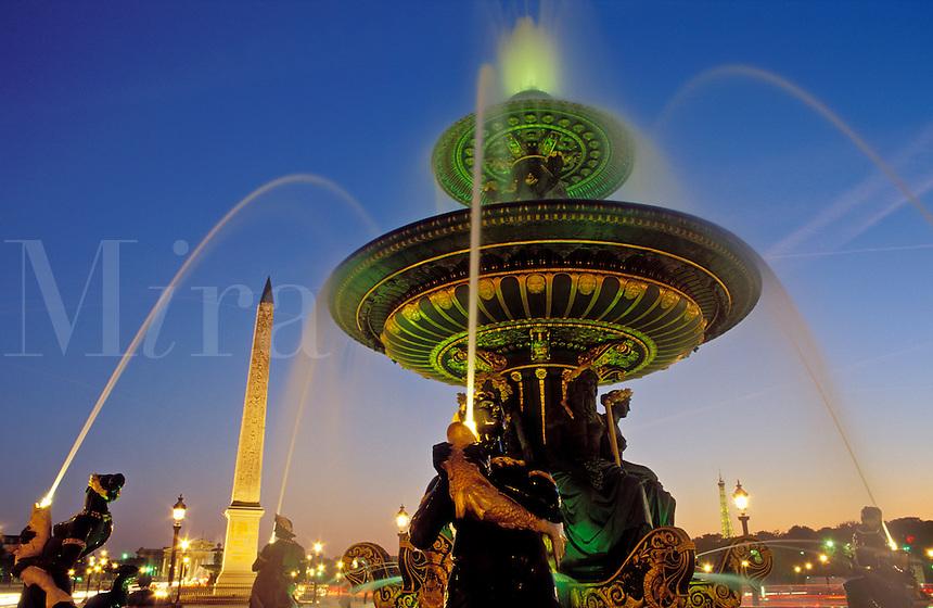France, Paris, Place de la Concorde, fountains illuminated at night