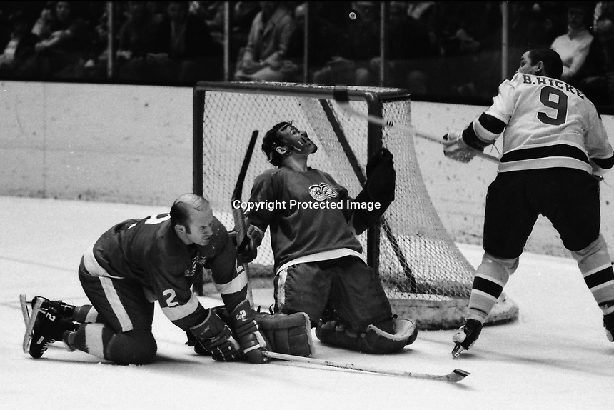 Seals vs Detroit RedWings 1971, Wings goalie Joe Daley blocks shot by Seals Bill Hickey, Wings #2 Gary <br />