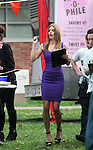 November 26th 2012<br /> <br /> Filming tv show 90201 at LA City College in Los Angeles California <br /> AnnaLynne McCord carrying a green apple laptop computer wearing a big black jacket with a fluffy fur hood. Smiling &amp; making funny faces while reading her script. Wearing a tight short purple skirt showing off her legs .  Jessica Lowndes &amp; Shenae Grimes &amp; Jessica Stroup<br /> <br /> AbilityFilms@yahoo.com<br /> 805 427 3519<br /> www.AbilityFilms.com