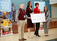 NWA Democrat-Gazette/DAVID GOTTSCHALK Ed Clifford (from left), chief executive officer at the Jones Center, stands Tuesday, March 6, 2018, with Erin Hogue, senior manager with the Walmart Foundation, Brandi Holt, advancement specialist, and Kelly Kemp-Mclintock, chief advancement officer, during a formal ceremony recognizing a $600,000 donation from the foundation to the Jones Center. The donation is the largest from the Walmart Foundation to the Jones Center. The money will be used for recreation operations, membership scholarships and event accessibility.