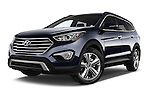 Stock pictures of low aggressive front three quarter view of a 2015 Hyundai Grand Santa Fe Executive 5 Door SUV