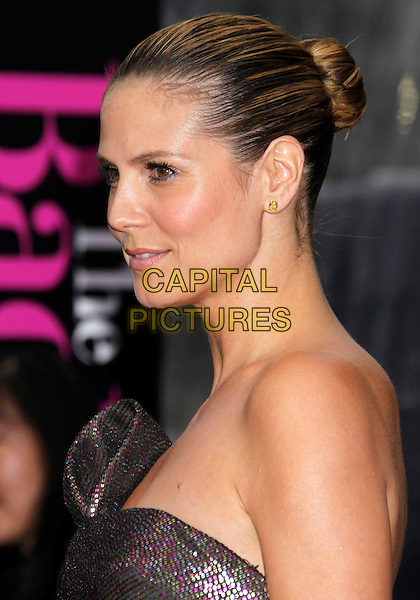 "HEIDI KLUM .""The Back-up Plan"" Los Angeles Premiere held at the Regency Village Theatre, Westwood, California, USA, 21st April 2010. .arrivals portrait headshot hair up  make-up beauty strapless brown shimmery shiny sparkly bronze gold pink purple sequined sequin green khaki side bun profile .CAP/ADM/MJ.©Michael Jade/AdMedia/Capital Pictures."