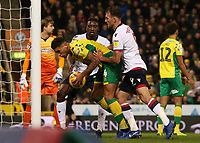 Bolton Wanderers' Sammy Ameobi &amp; Christian Doidge try to prise the ball from Norwich City's Ben Godfrey to get the game going again <br /> <br /> Photographer David Shipman/CameraSport<br /> <br /> The EFL Sky Bet Championship - Norwich City v Bolton Wanderers - Saturday 8th December 2018 - Carrow Road - Norwich<br /> <br /> World Copyright &copy; 2018 CameraSport. All rights reserved. 43 Linden Ave. Countesthorpe. Leicester. England. LE8 5PG - Tel: +44 (0) 116 277 4147 - admin@camerasport.com - www.camerasport.com