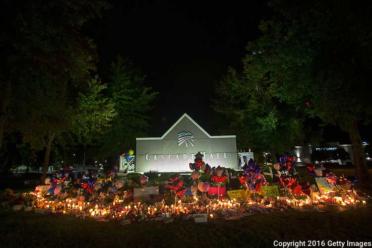 BURLINGTON, WA - SEPTEMBER 26: A memorial shines bright in front of the Cascade Mall on September 26, 2016 in Burlington, Washington. Five people were killed by a gunman several nights ago at the Cascade Mall. The suspect, Arcan Cetin, 20, a resident of Oak Harbor, Washington, was arraigned today. (Photo by Karen Ducey/Getty Images)