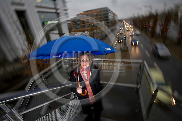 LUXEMBOURG - LUXEMBOURG - 18 JANUARY 2008 -- Tonika HIRDMAN, Country Executive ABN AMRO Bank Luxembourg, pictured  with a umbrella on a walkingbridge next to her officebuilding at Av. J.F. Kennedy. Photo: Erik Luntang/EUP-IMAGES/