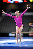 02/20/09 - Photo by John Cheng for USA Gymnastics.  US gymnast Kamerin Moore performs on Vault in a meet against Japan before the Tyson American Cup at Sears Centre Arena in Chicago.