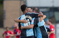 Luke O'Nien (centre) of Wycombe Wanderers runs to celebrate Wycombe third goal with Aaron Amadi Holloway (left) of Wycombe Wanderers and Garry Thompson of Wycombe Wanderers during the Sky Bet League 2 match between Wycombe Wanderers and York City at Adams Park, High Wycombe, England on 8 August 2015. Photo by Andy Rowland.