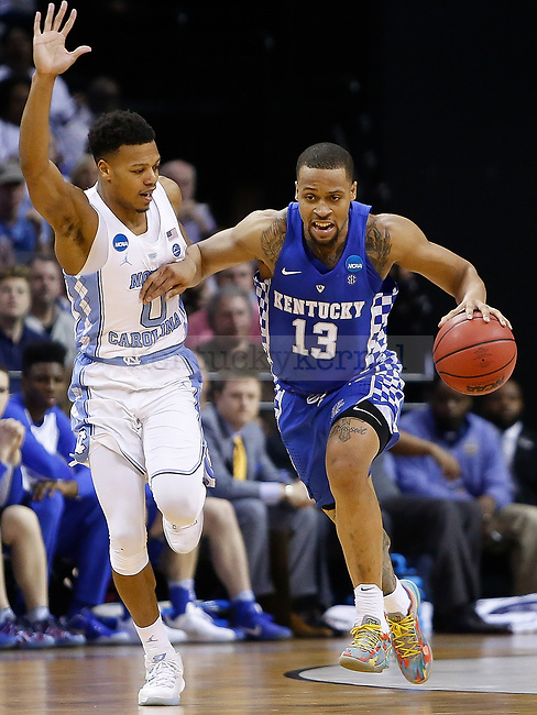 Kentucky Wildcats guard Isaiah Briscoe drives up the court against North Carolina Tar Heels guard Nate Britt during the 2017 NCAA Men's Basketball Tournament South Regional Elite 8 at FedExForum in Memphis, TN on Friday March 24, 2017. Photo by Michael Reaves | Staff