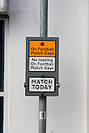 """Portsmouth 1 Southampton 1, 18/12/2012. Fratton Park, Championship. A street sign outside Fratton Park stadium before Portsmouth take on local rivals Southampton in a Championship fixture. Around 3000 away fans were taken directly to the game in a fleet of buses in a police operation known as the """"coach bubble"""" to avoid the possibility of disorder between rival fans. The match ended in a one-all draw watched by a near capacity crowd of 19,879. Photo by Colin McPherson."""
