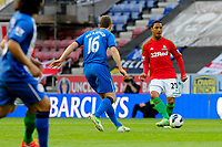 Tuesday, 7 May 2013<br /> <br /> Pictured: James McArthur of Wigan Athletic goes to challenge Jonathan de Guzman of Swansea City <br /> <br /> Re: Barclays Premier League Wigan Athletic v Swansea City FC  at the DW Stadium, Wigan