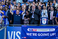 Cardiff owner Vincent Tan (left) celebrates promotion behind his team's manager Neil Warnock after the Sky Bet Championship match between Cardiff City and Reading at the Cardiff City Stadium, Cardiff, Wales on 6 May 2018. Photo by Mark  Hawkins / PRiME Media Images.