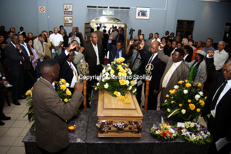 "DURBAN - 30 April 2006 - Black Consciousness members salute at the funeral of Strinivasa Rajoo ""Strini"" Moodley, one of the founders of the movement who served a six-year jail term on Robben Island and was a friend of Steve Biko. Picture: Giordano Stolley"