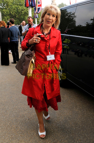 JENNIE BOND.arriving for TV recording of the Royal Wedding, London, England, .UK, 28th April 2011..full length red trench coat belt belted white shoes bag walking open toe pass .CAP/IA.©Ian Allis/Capital Pictures.
