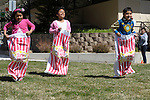 From left, Alondra Pierrott, 7, Kimberly Herrera, 8, and Isaac Ledezma, 6, all of Carson City, take part in a sack race during the 7th Annual Easter Fiesta at Western Nevada College Saturday, March 26, 2016. The event, hosted by the Association of Latin American Students, had 3 separate egg hunts, face painting, limbo, musical chairs, ring toss, sack races, bowling,  food, music and a piñata.  <br />