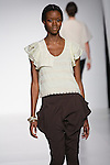 Model walks runway in an outfit from the La Jaune Fontange collection by Sunjee Kim, during the Pratt 2011 fashion show.