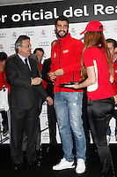 Real Madrid player Raul Albiol (r) and the President Florentino Perez participate and receive new Audi during the presentation of Real Madrid's new cars made by Audi at the Jarama racetrack on November 8, 2012 in Madrid, Spain.(ALTERPHOTOS/Harry S. Stamper) .<br />