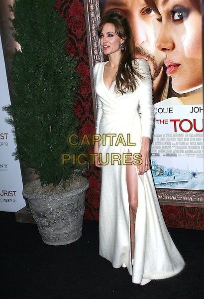 ANGELINA JOLIE .World premiere of 'The Tourist' at Ziegfeld Theatre in New York City, NY, USA, 6th December 2010..full length white wrap fluffy angora long sleeve maxi slit split shoes dress.CAP/ADM/PZ.©Paul Zimmerman/AdMedia/Capital Pictures.