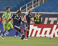 New England Revolution midfielder Shalrie Joseph (21) passes the ball. In a Major League Soccer (MLS) match, the Seattle Sounders FC defeated the New England Revolution, 2-1, at Gillette Stadium on October 1, 2011.