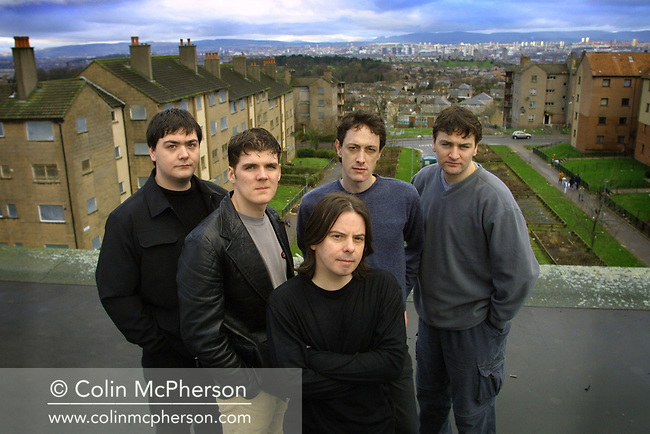 The members of the band the Cosmic Rough Riders, pictured in their native Castlemilk, a sprawling estate on the south side of Glasgow, Scotland where their studio was located. They were a pop/rock band from Glasgow, Scotland, originally formed in 1998 by Daniel Wylie and Stephen Fleming..