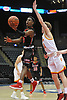 Savion Lewis #3 of Half Hollow Hills East, left, makes an acrobatic move during the second quarter of a non-league varsity boys basketball game against Chaminade at Nassau Coliseum in Uniondale on Sunday, Jan. 21, 2018. He departed the game early in the fourth quarter having scored a school record 50 points, including 20 in the second quarter, to lead Hills East to a 90-68 win.