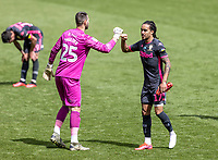 Leeds United's Helder Costa (right) bumps fists with Swansea City's substitute goalkeeper Erwin Mulder at the end of the match<br /> <br /> Photographer Andrew Kearns/CameraSport<br /> <br /> The EFL Sky Bet Championship - Swansea City v Leeds United - Sunday 12th July 2020 - Liberty Stadium - Swansea<br /> <br /> World Copyright © 2020 CameraSport. All rights reserved. 43 Linden Ave. Countesthorpe. Leicester. England. LE8 5PG - Tel: +44 (0) 116 277 4147 - admin@camerasport.com - www.camerasport.com