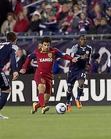 Real Salt Lake defender Tony Beltran (2) passes as New England Revolution midfielder Sainey Nyassi (17) closes. In a Major League Soccer (MLS) match, Real Salt Lake defeated the New England Revolution, 2-0, at Gillette Stadium on April 9, 2011.