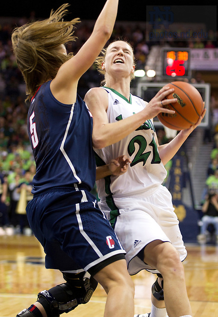 January 7, 2012; Notre Dame Fighting Irish guard Natalie Novosel drives to the net past Connecticut Huskies guard Caroline Doty during the second half at the Purcell Pavilion. Notre Dame won 75 to 67 in overtime. Photo by Barbara Johnston/University of Notre Dame